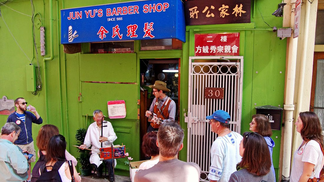 Music outside Jun Yu's Barber Shop with Wes on his ukulele