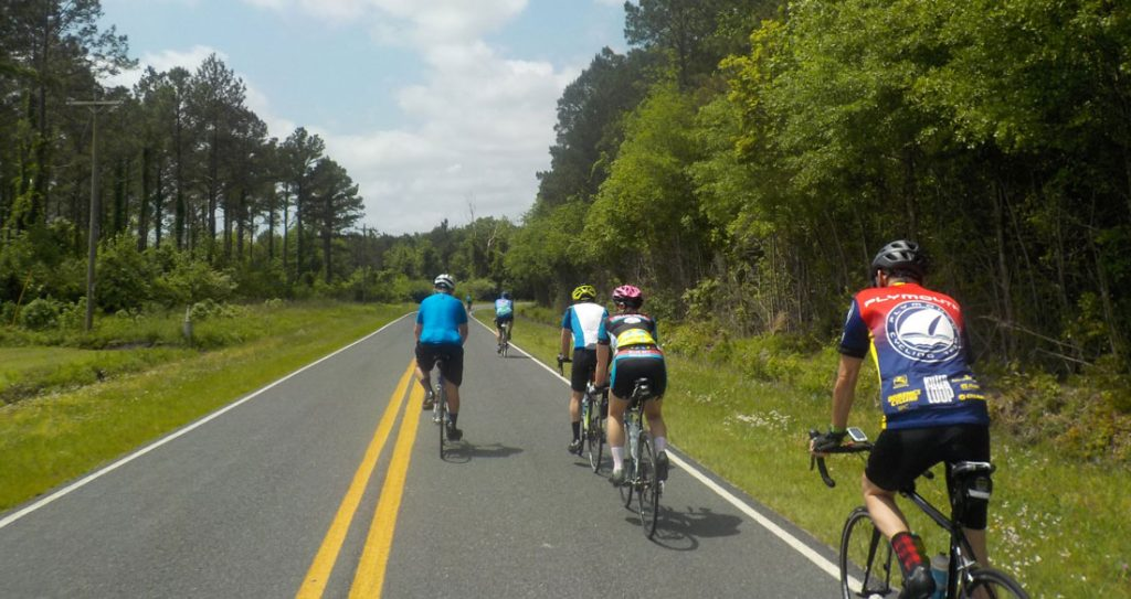 Enjoy coastal bike ride scenery with other riders