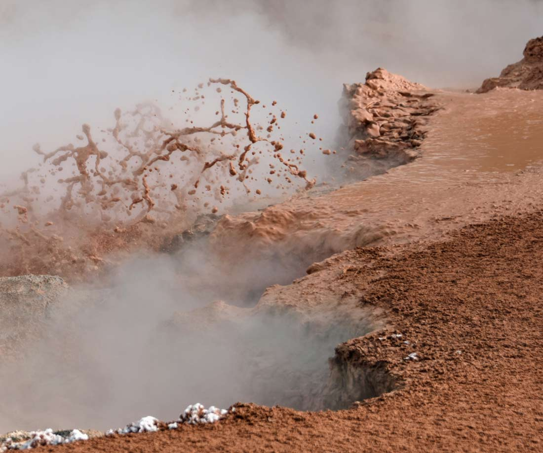 Winter steam on thermal pools makes this bubbling mud all the more dramatic at Artists Paint Pots.