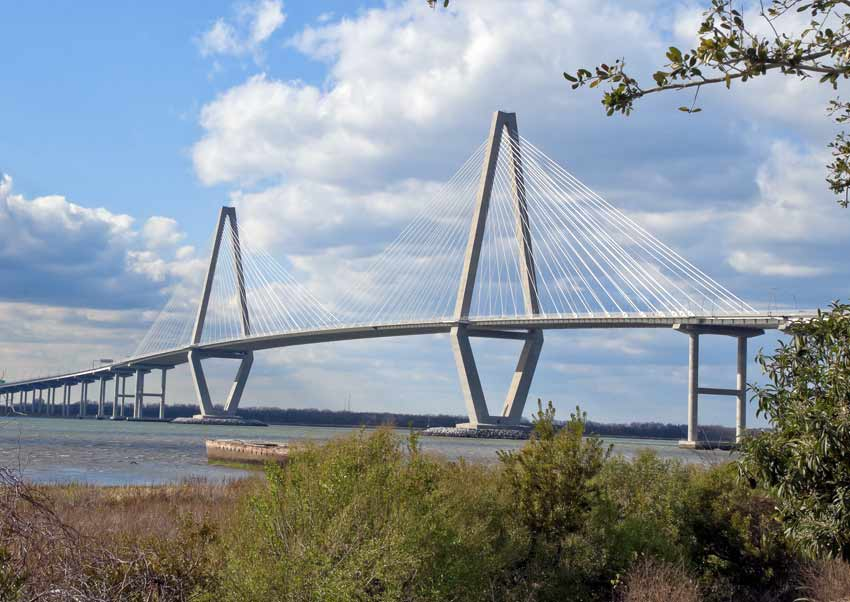 Crossing the Ravenel (Cooper River) Bridge is safe for walking, jogging and biking thanks to a barrier-protected pedestrian lane.